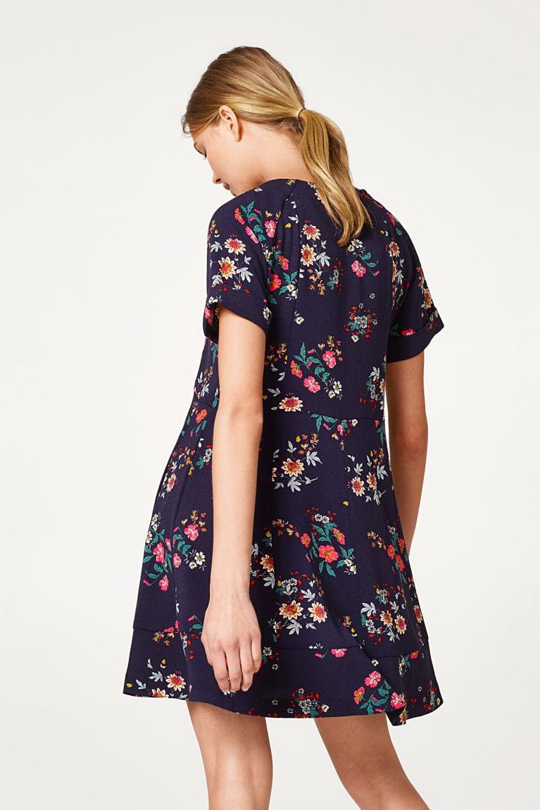 Ausgestelltes Crêpe-Kleid mit Blüten