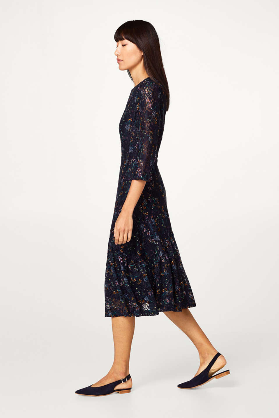 Lace dress with a floral pattern and frilled trim