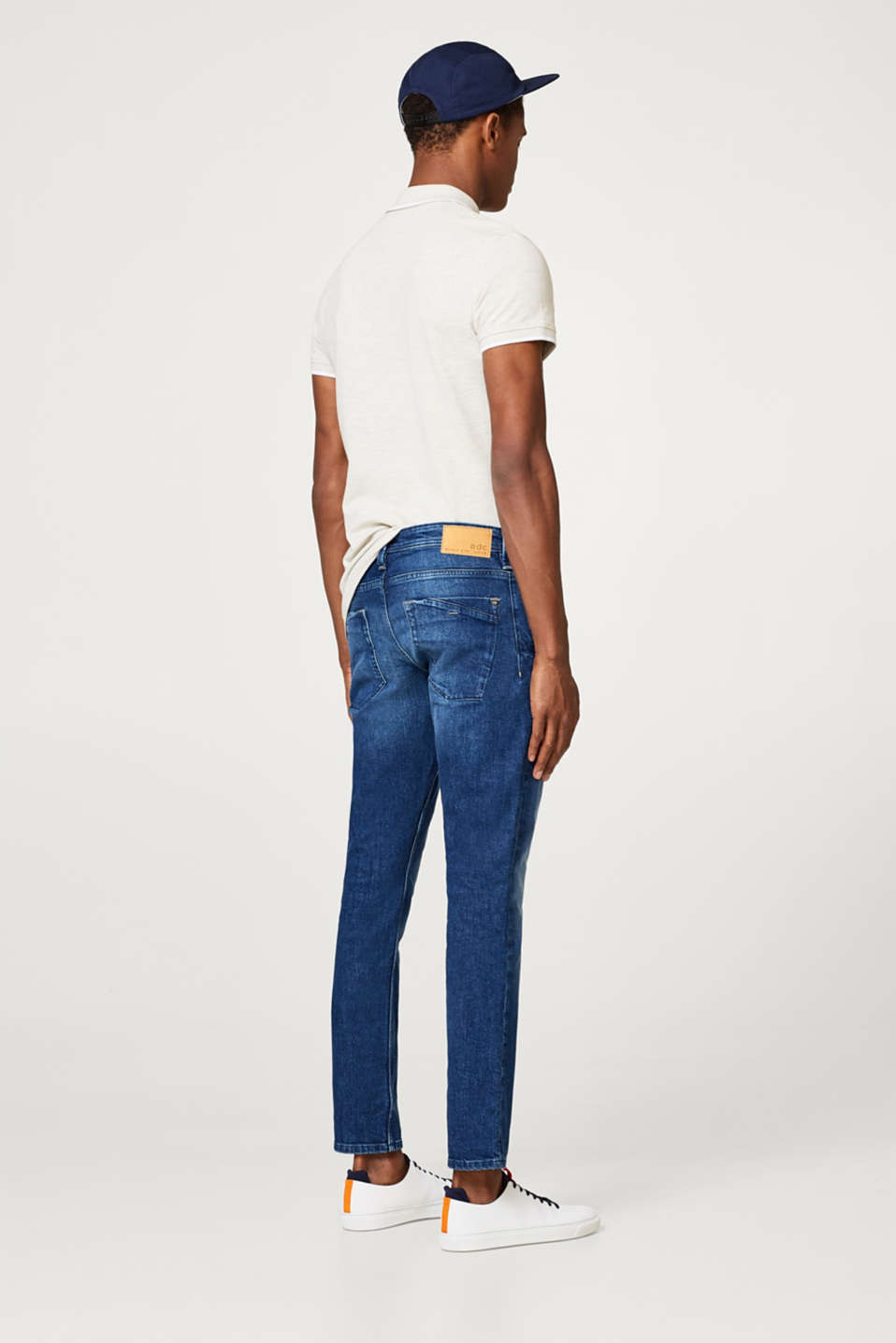 Stretch jeans with a zip detail and a vintage wash