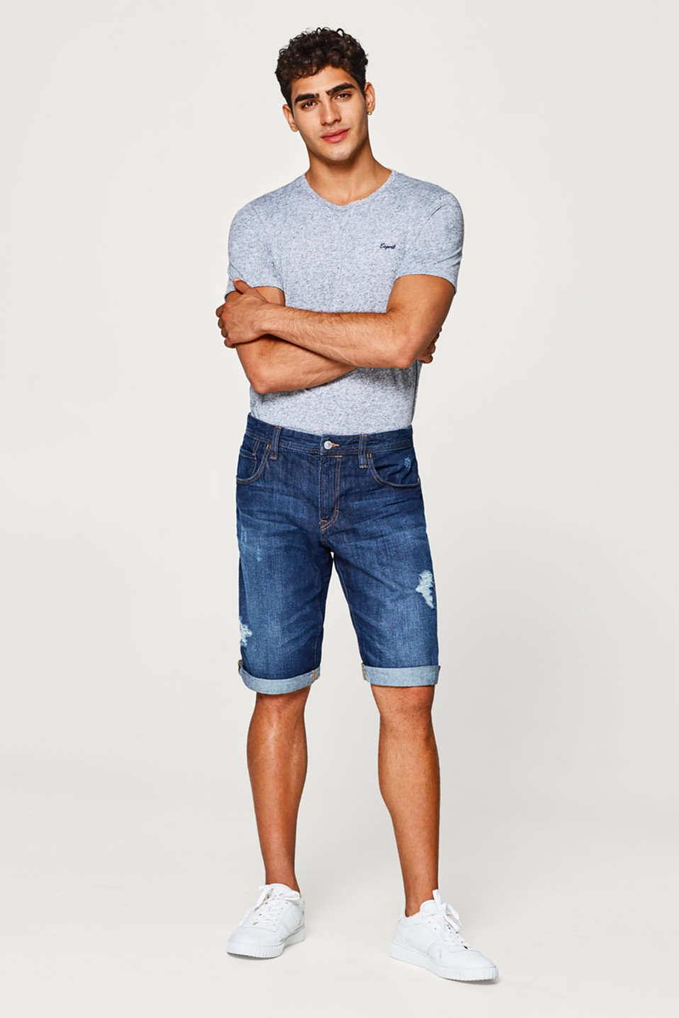 Denim shorts with distressed effects, made of cotton