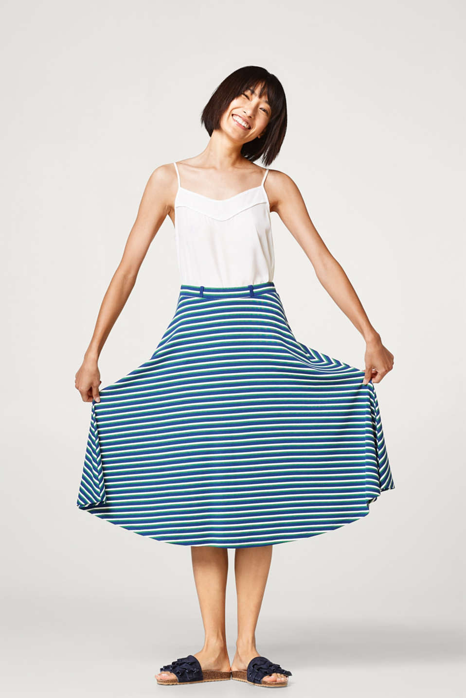 Swirling midi skirt in firm jersey