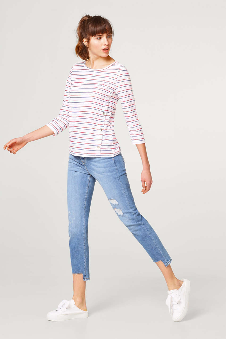 Textured striped top with a decorative button placket