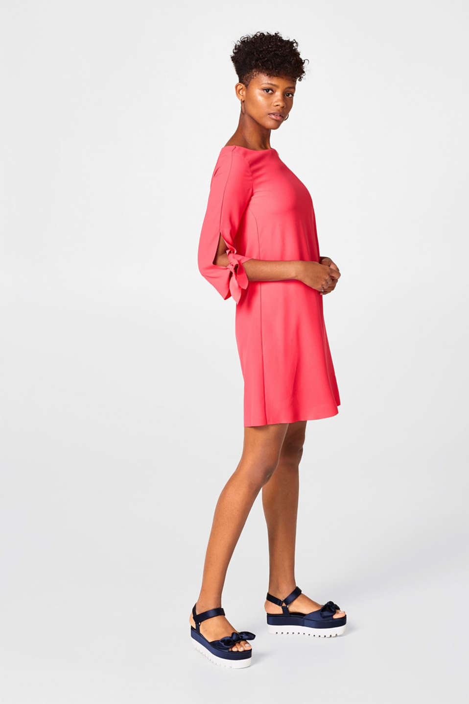 Softly draped dress with laser-cut detailing