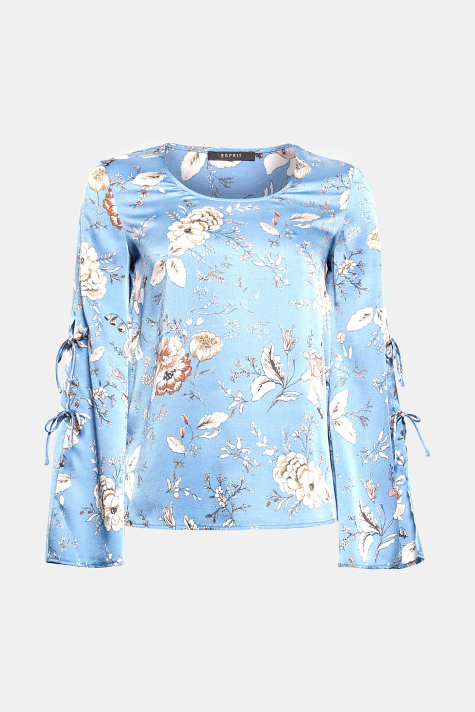 The three-quarter length bell sleeves are decoratively highlighted by bow-fastening ties on this printed blouse.