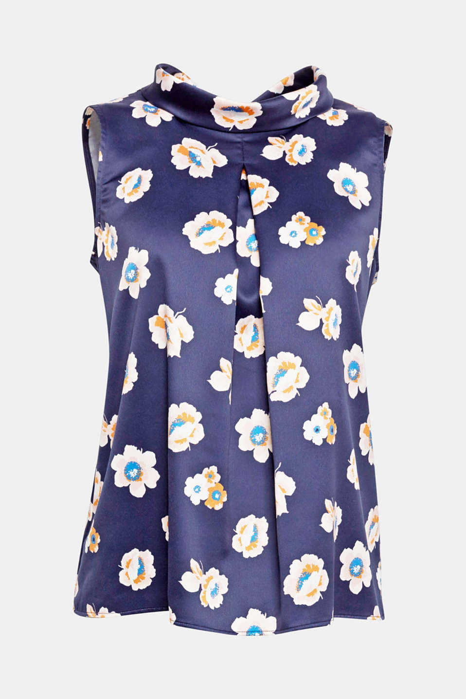 Feminine Flower Power! This blouse is distinguished by the inset pleat, floral print and turn-down collar.