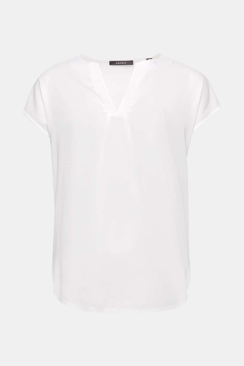With a rounded hem and V-neckline: blouse top with slightly dropped shoulders.