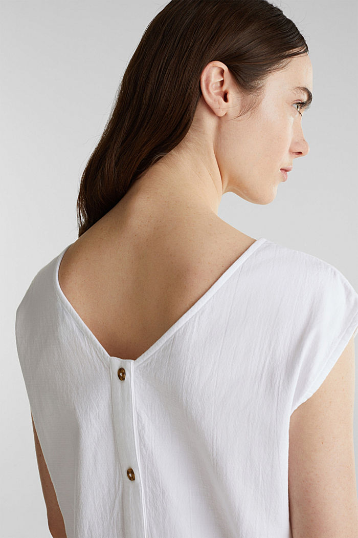 Blouse top with button placket on the back