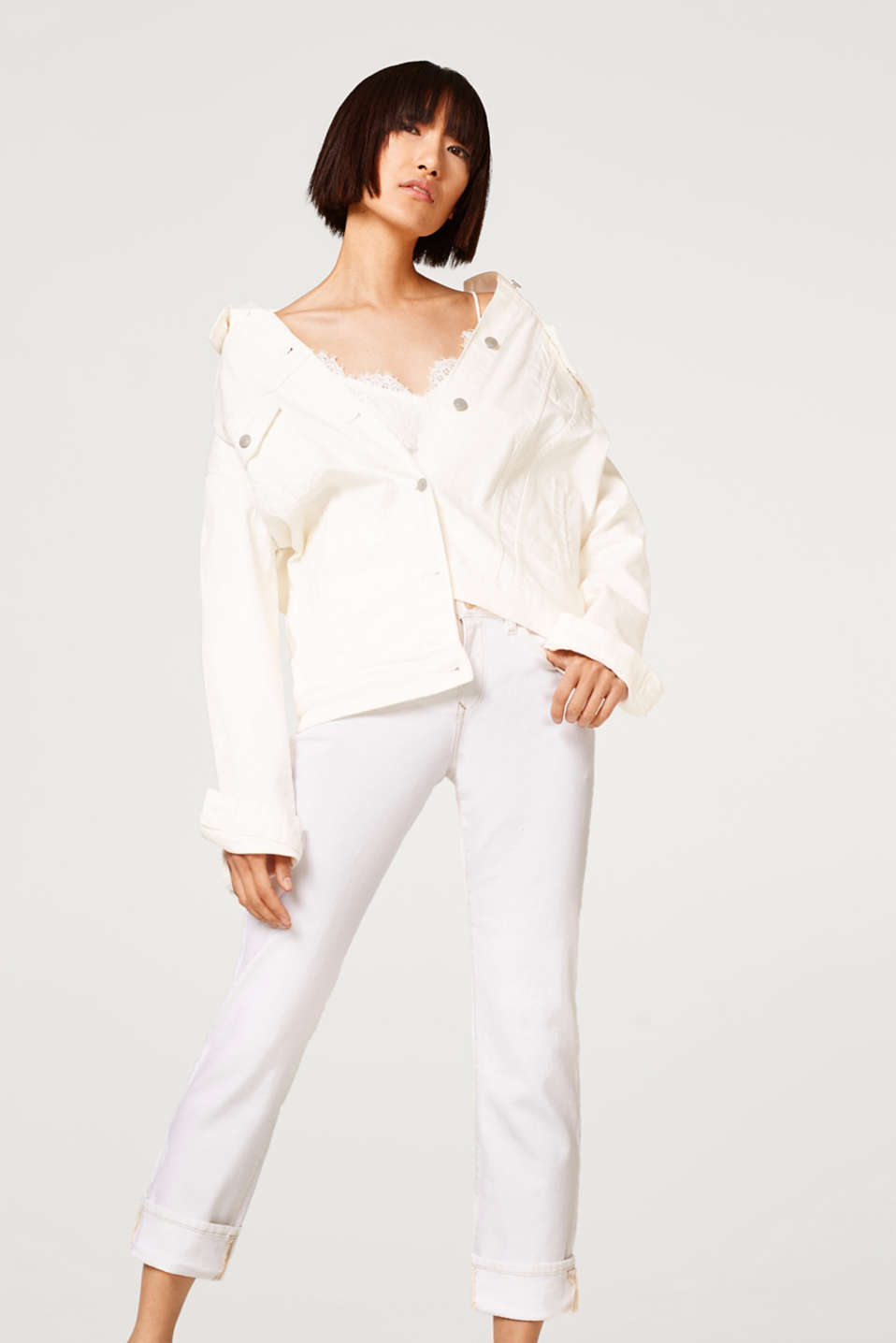 White stretch jeans with contrasting stitching