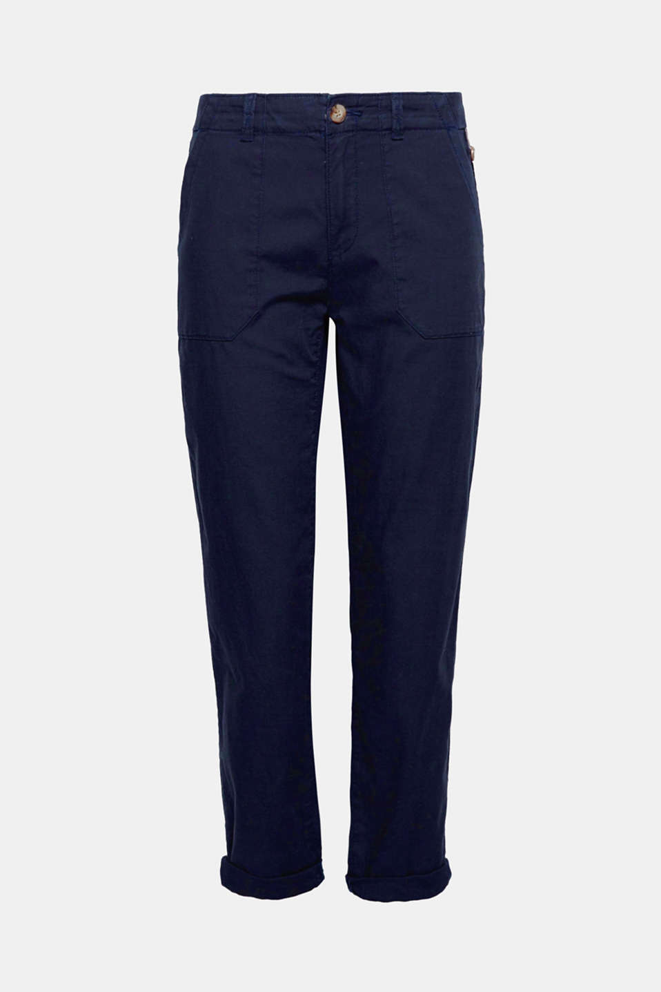 These trousers are an unfussy summer piece made of pure cotton with utility style patch pockets.