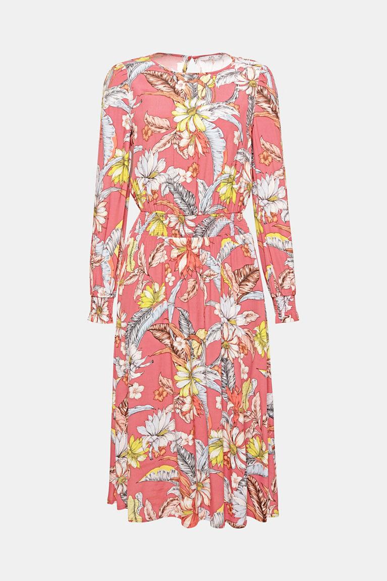 Vrouwelijke bloemen: de opvallende print all-over geeft deze soepelvallende jurk met gesmokte details en modieuze midilengte een extra charmante look!