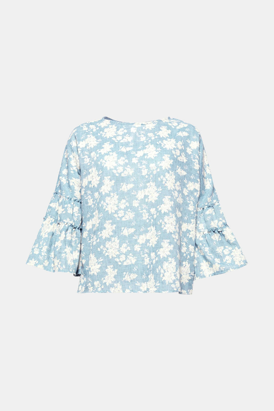 This blouse exudes pure romance with a light and airy textured pattern, a delicate floral print and three-quarter length flounce sleeves!