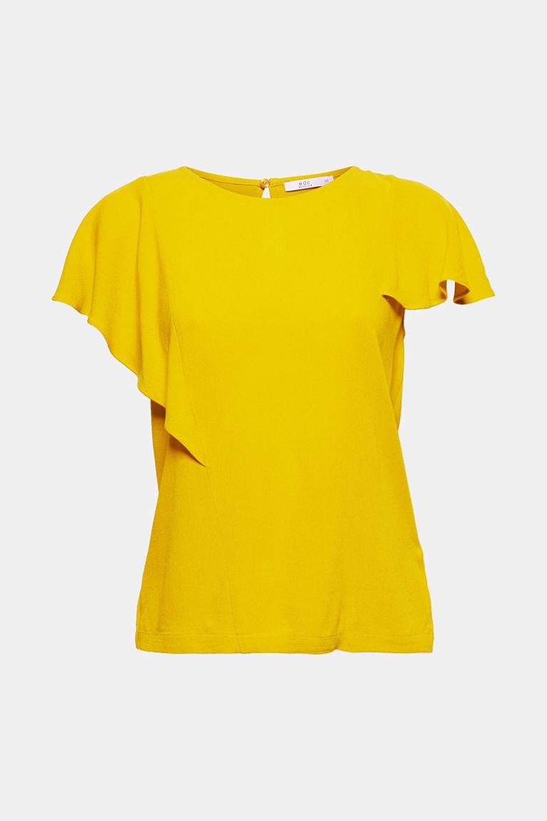 Een rechte en een asymmetrische mouw met volants geven deze soepele blouse van crêpe een onmiskenbare look!
