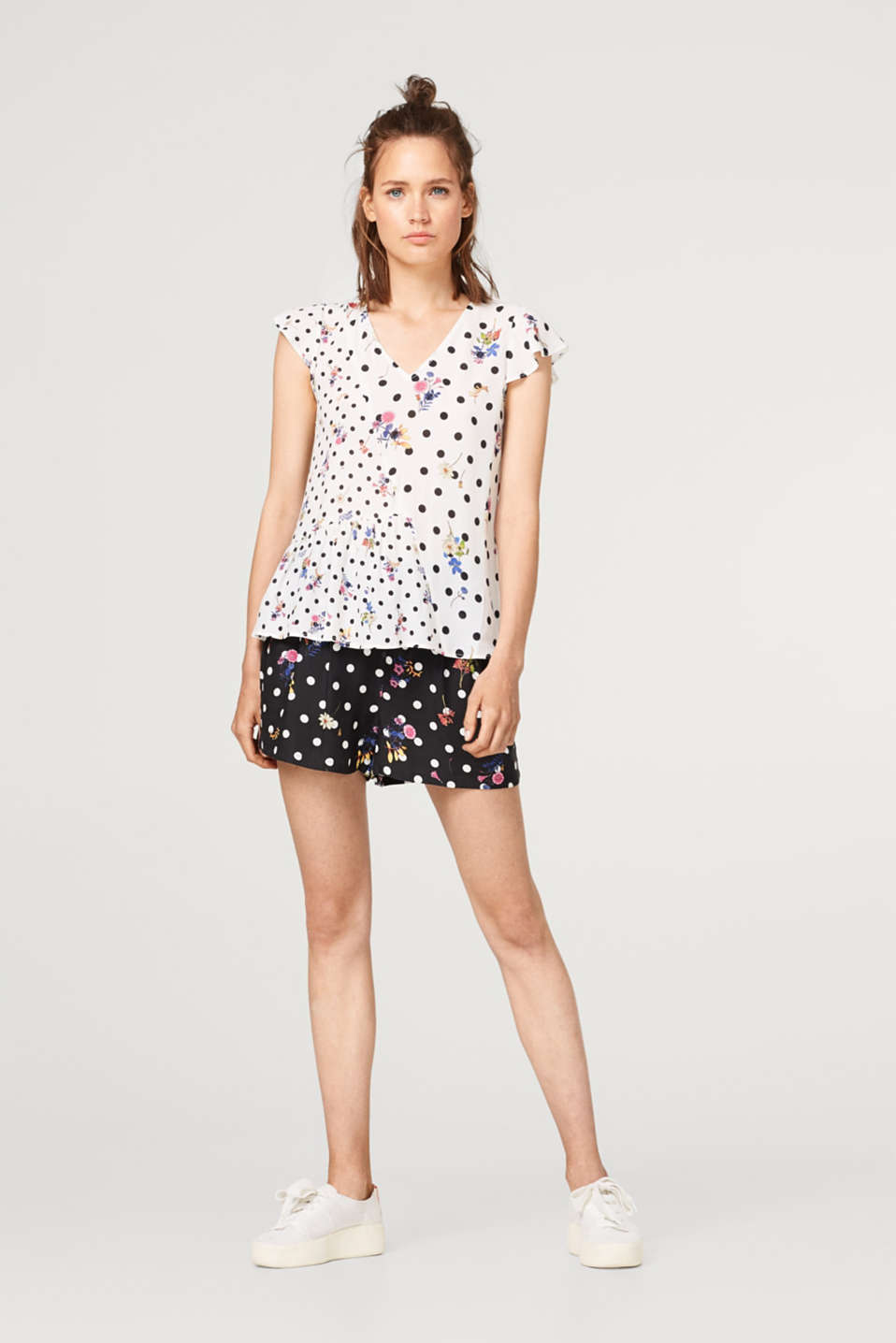 Blouse top with flounces in a mix of patterns