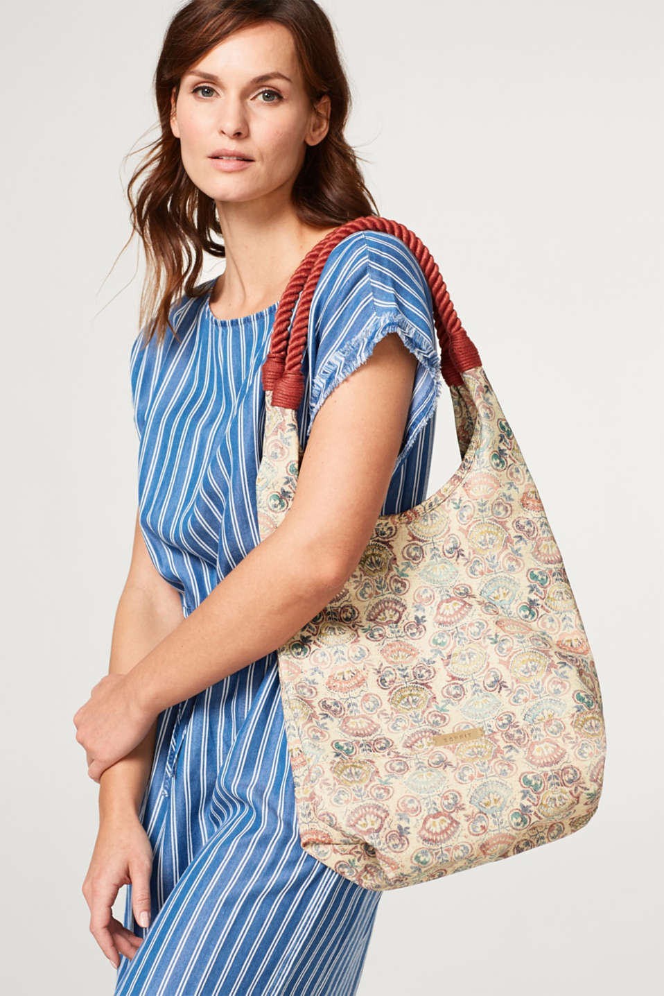 Patterned shoulder bag in a rustic wash