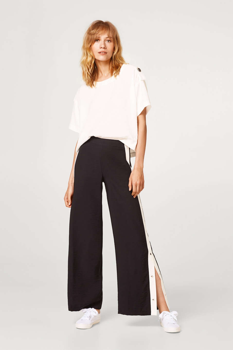 Esprit - Flared trousers with stripes and a press stud placket