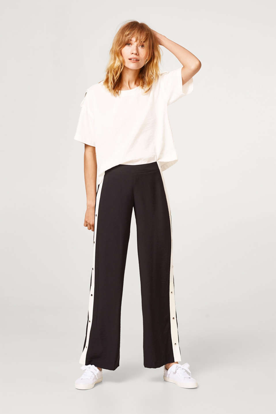 Flared trousers with stripes and a press stud placket