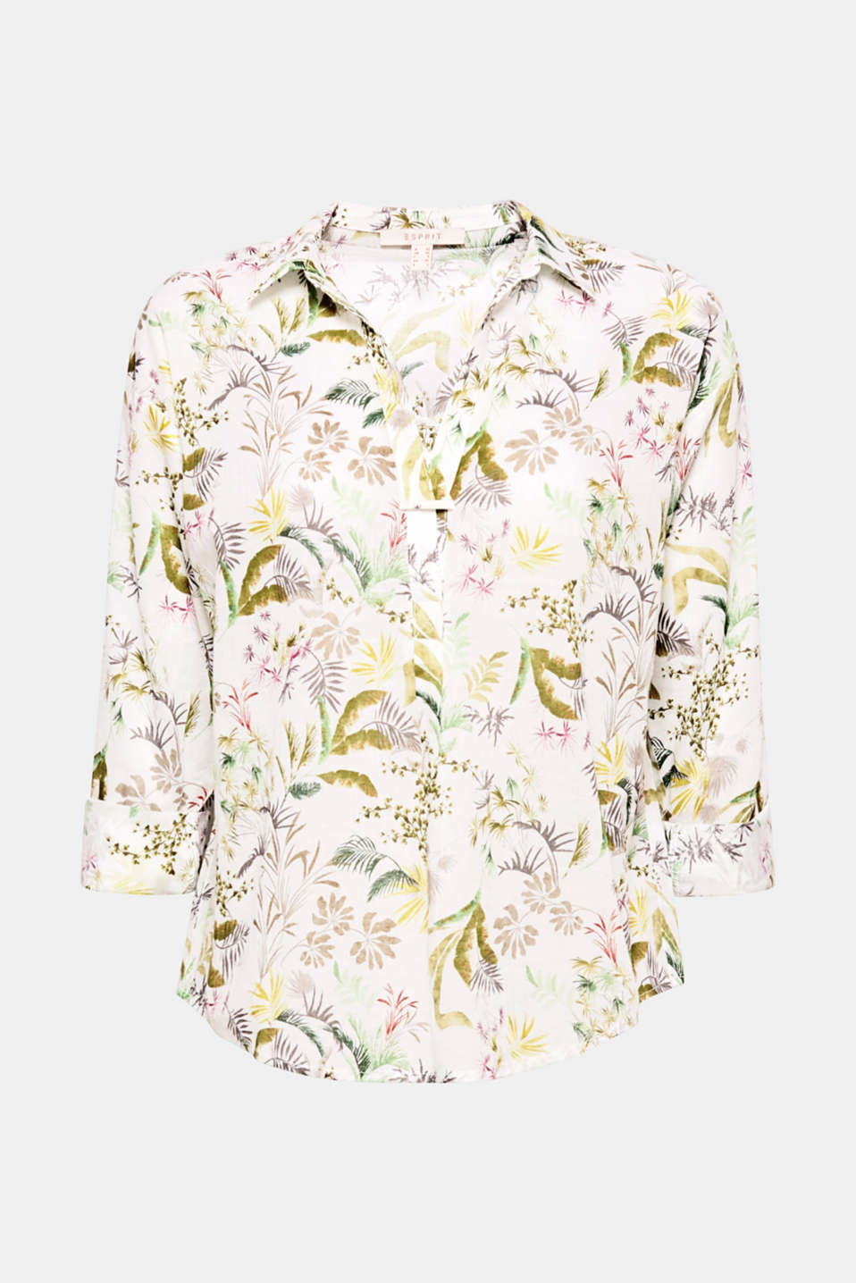 Off to tropical lands! The fine tropical print with leaves and blossoms defines this blouse along with the casual boxy design.
