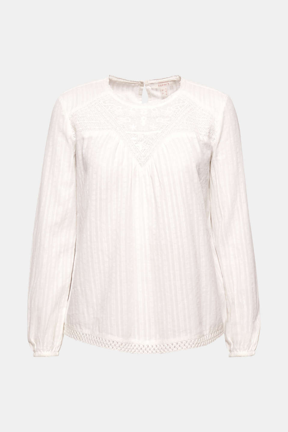 The neckline in broderie anglaise, the fine embroidery and a lace hem give this blouse its romantic flair.