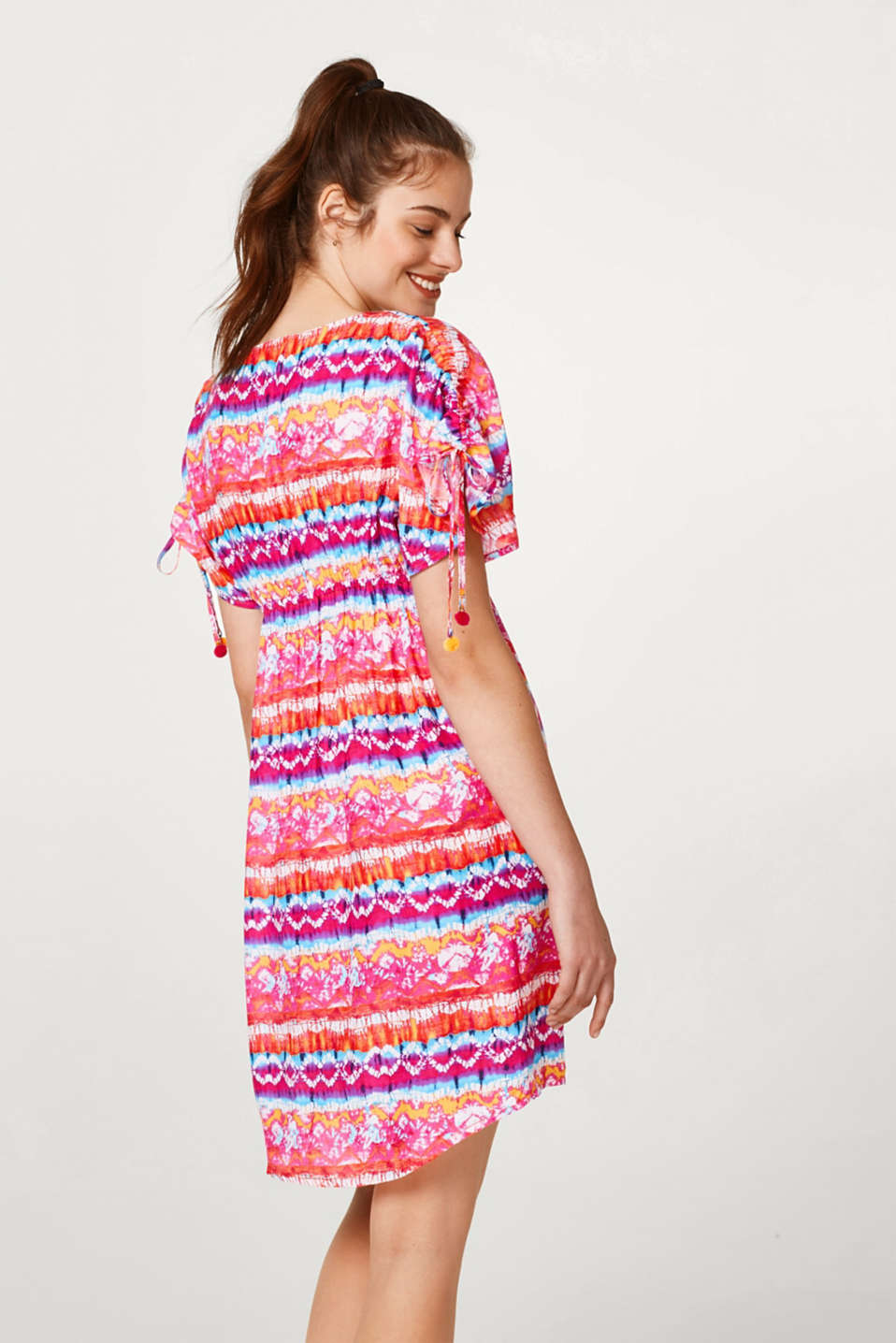 Light and airy beach dress with a colourful print