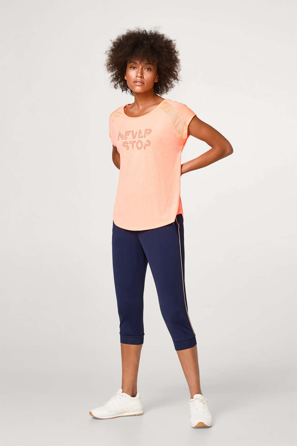 Airy T-shirt with a neon print and mesh details