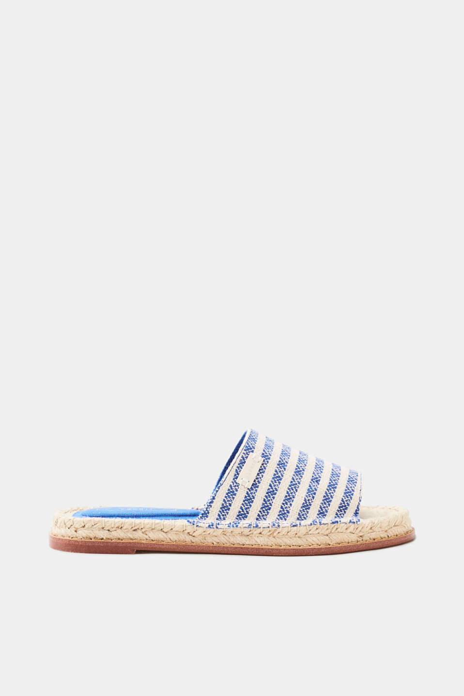 Go stylishly through the summer: open-toe mules with striped woven straps