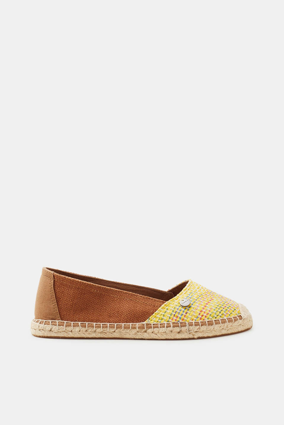 A summer classic: espadrilles. The brightly coloured, woven pattern and bast trim make these ones something special.