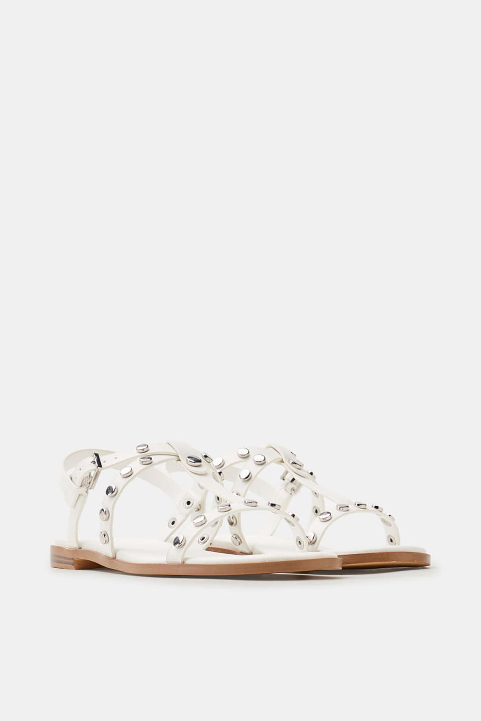 Flat sandals in faux leather with a decorative studs