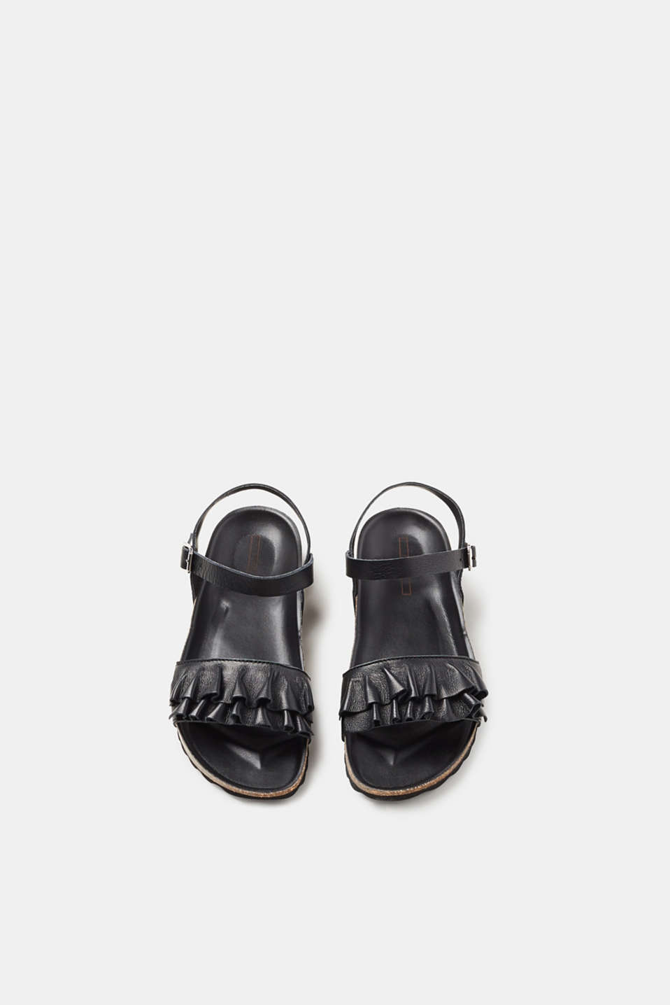 Leather sandals with a footbed and feminine frills