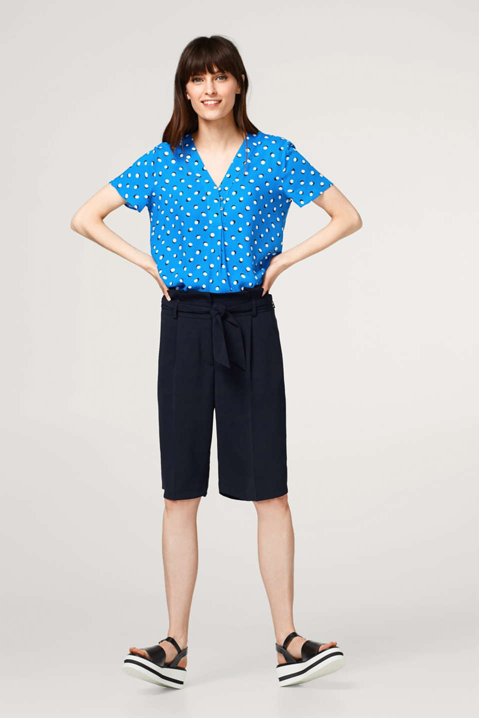Polka dot blouse top with an inverted pleat