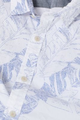Short sleeve shirt with a tropical print