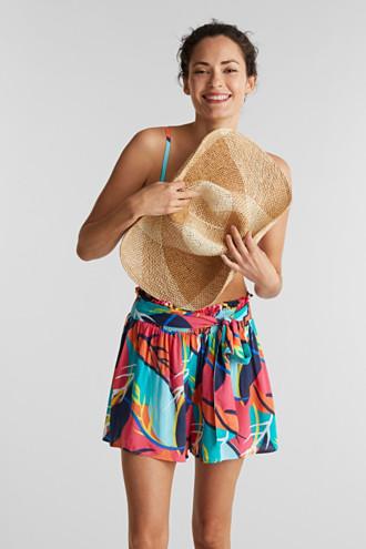 Beach shorts with a tropical print