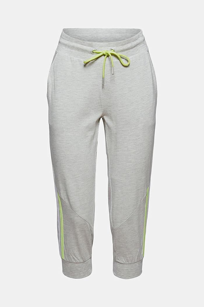 En matière recyclée: le pantalon de sport en jersey, animé de détails de couleur fluo