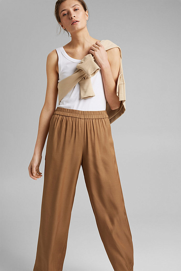 Wide trousers with elasticated waistband