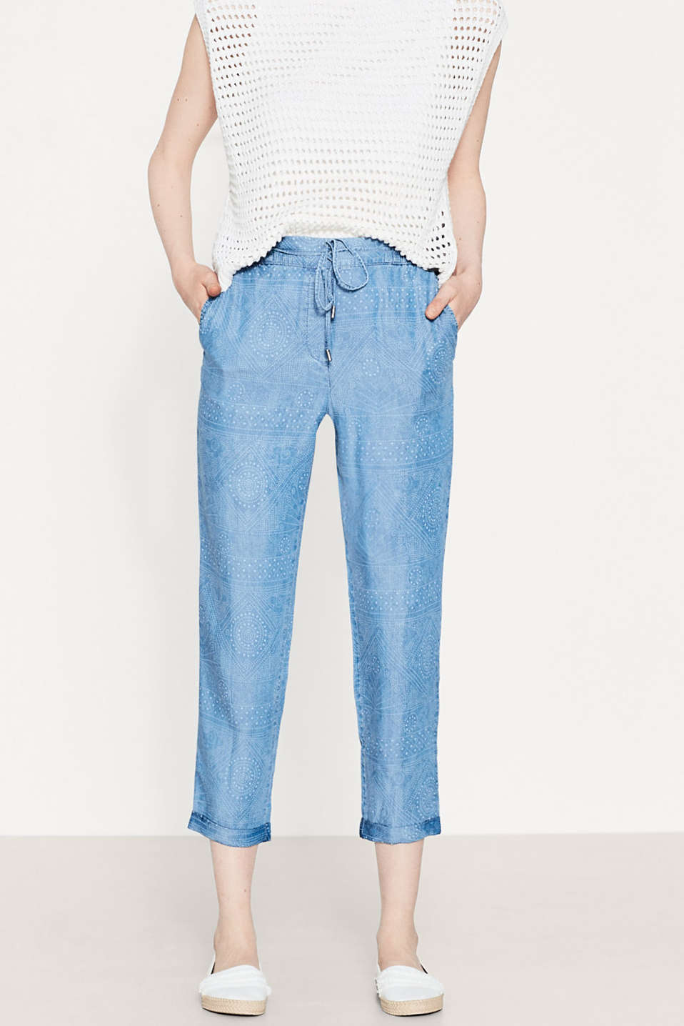 Flowing trousers with elasticated waistband