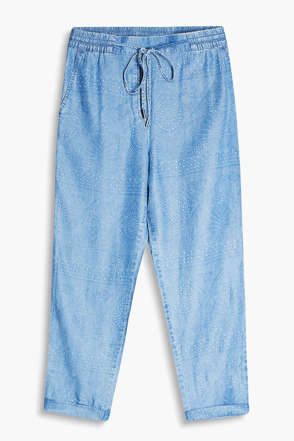 Casual trousers in flowing fabric with an ornamental print, elasticated waistband and turn-up hems