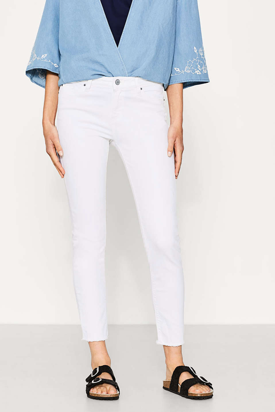 White stretch jeans with vintage effects