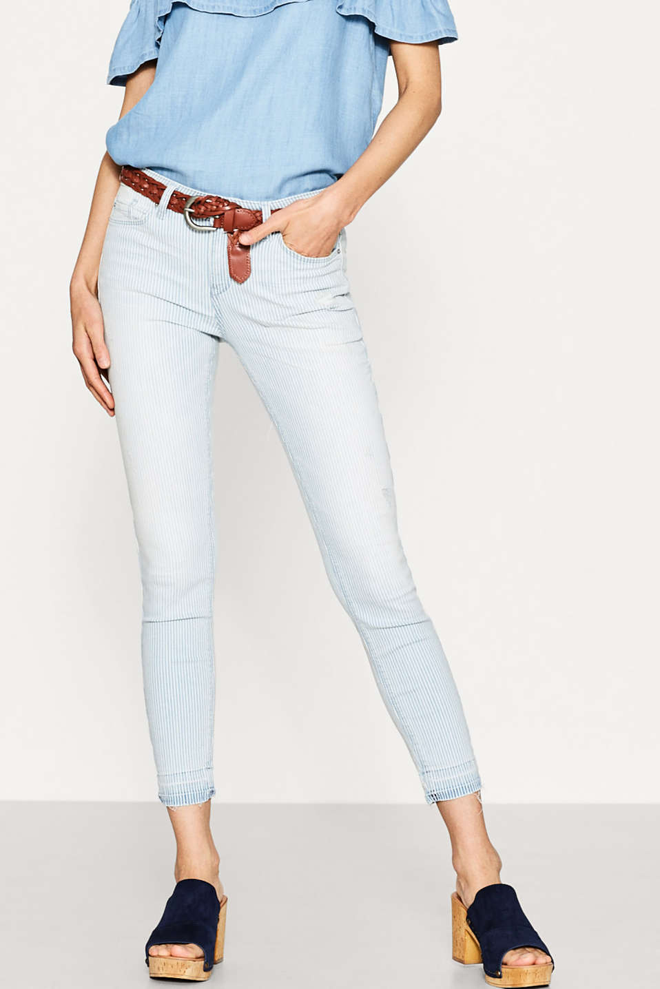 Striped stretch jeans with frayed hems