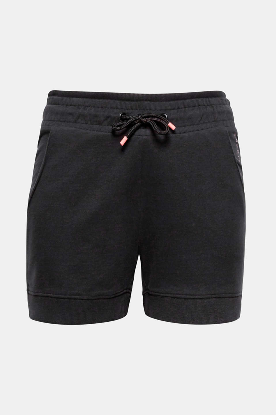 Wear these ultra comfortable shorts in lightweight jersey with ribbed trims and neon-coloured details for sports or simply in your free time!
