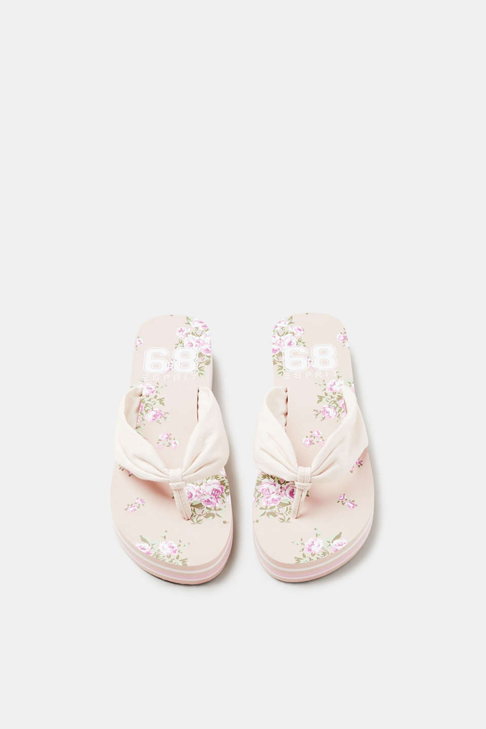 Toe-post sandals with a floral printed platform sole