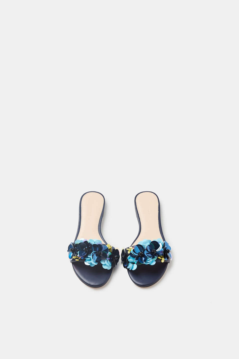 Mules with sequins arranged in a floral style