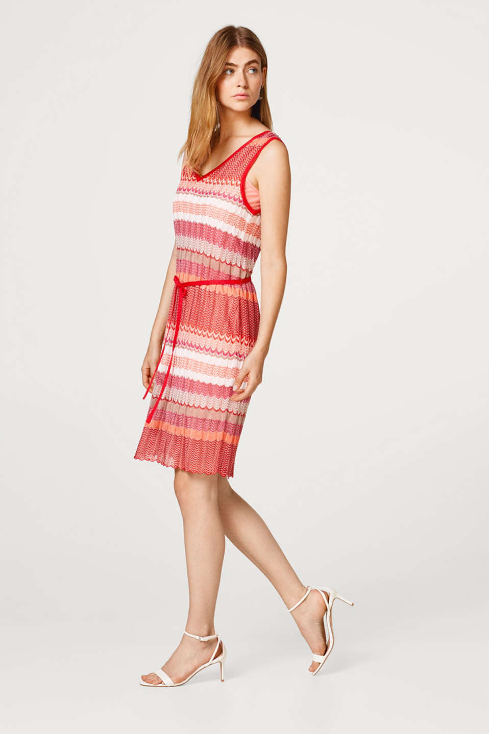 Dress composed of openwork knit fabric with a zigzag pattern