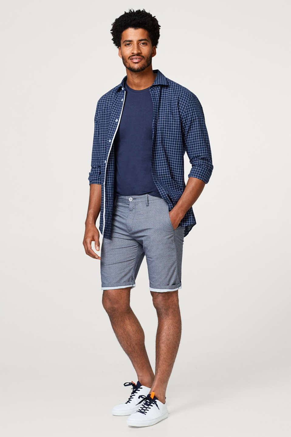 Chino shorts with a fine polka dot pattern