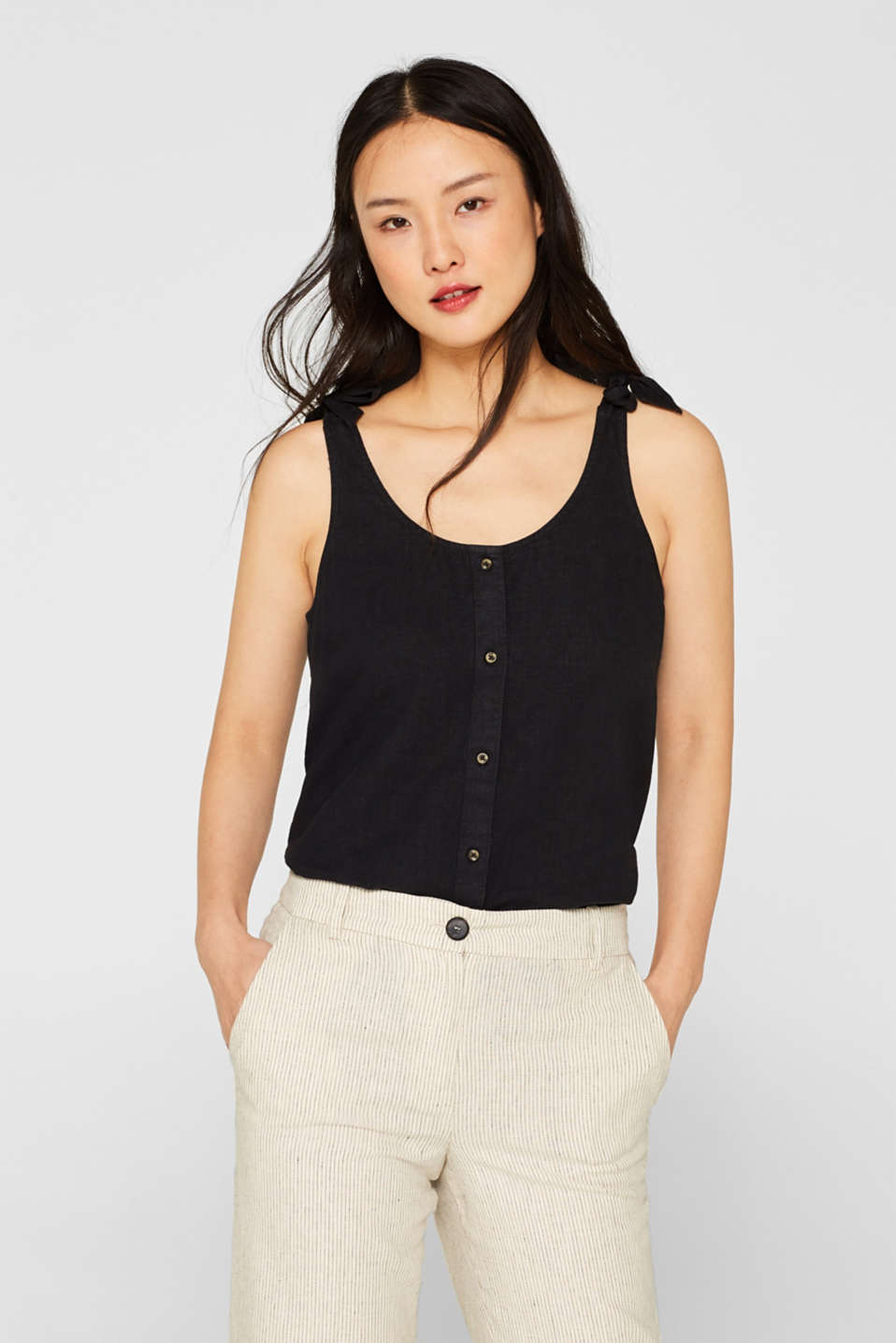 Made of blended linen: top with bow straps