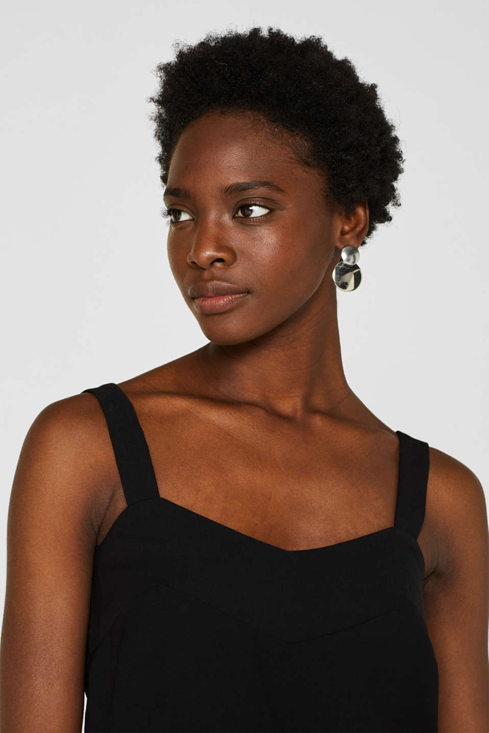 Woven top with a flat V-neckline