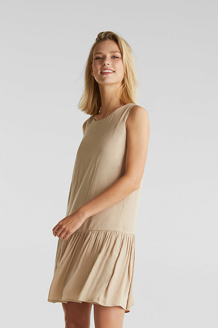Woven dress with a flounce hem