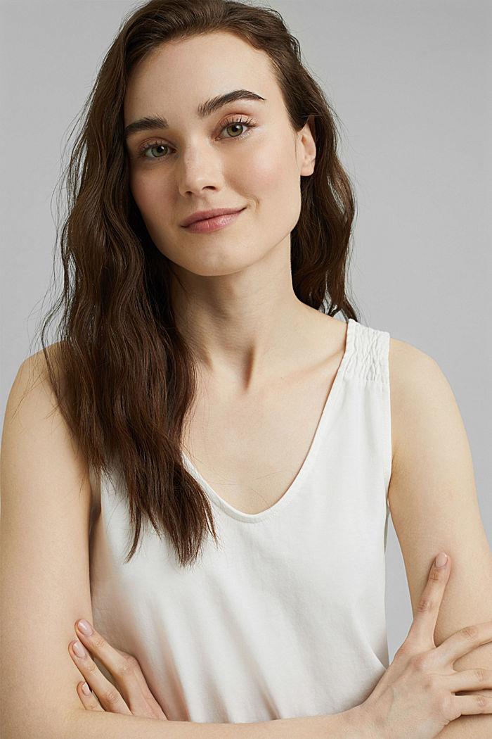 Linne med smockade axelband