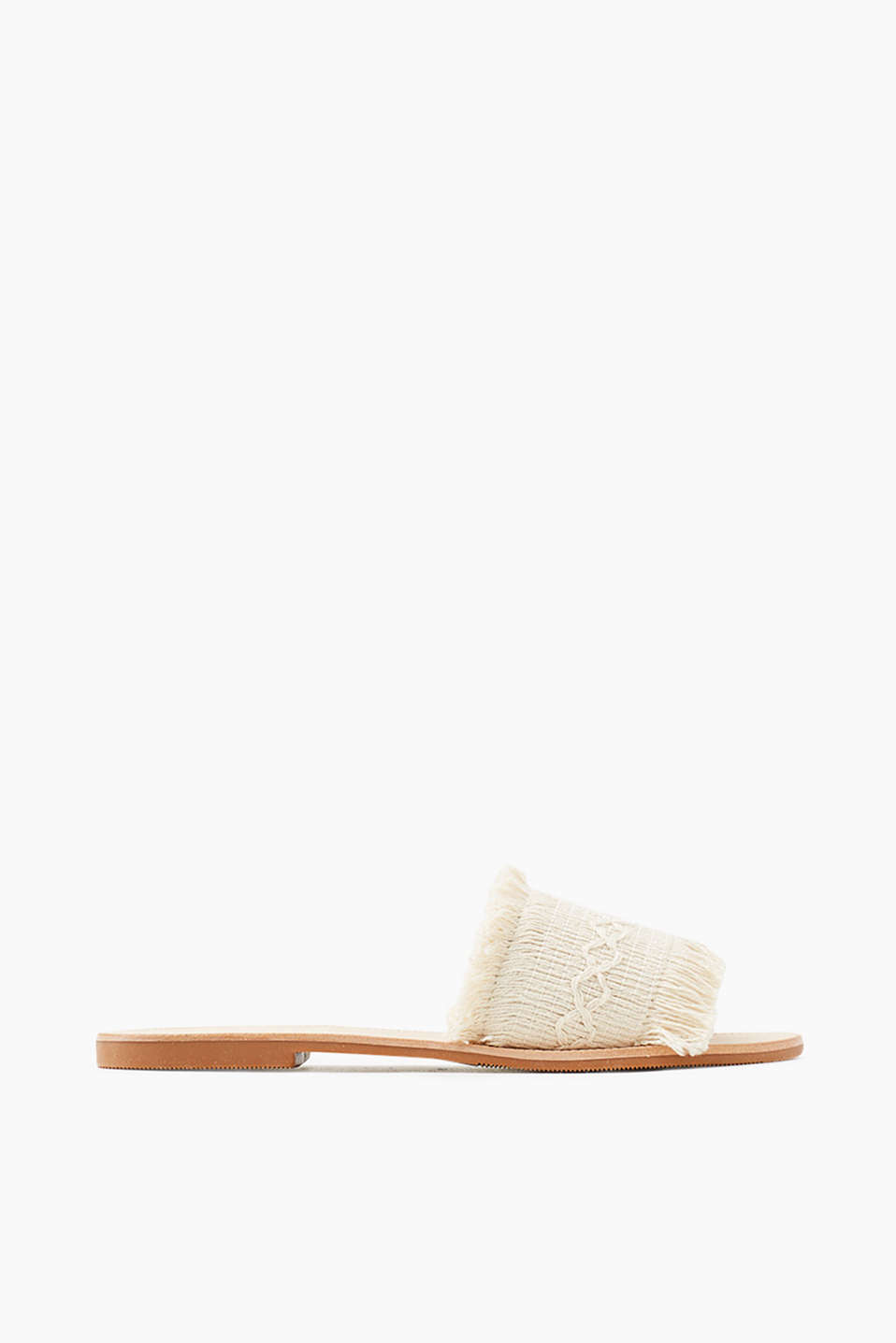 Open mules in a summery look with stylish, woven cotton straps with fringing