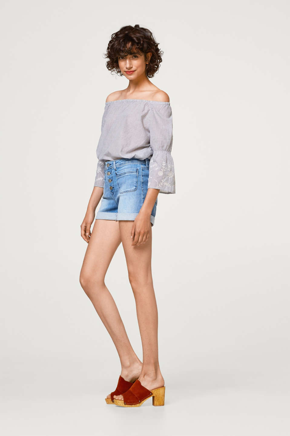 Stretch denim shorts with a button placket