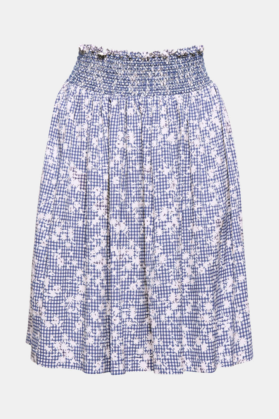 Gives your summer style a swing: this airy, flared skirt with gingham check pattern with flowers and wide smocked waistband.