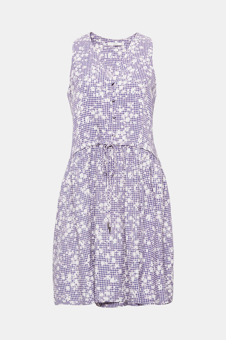 This dainty strap dress exudes floaty lightness and features a gingham check pattern, embellished with flowers. It comes with an adjustable drawstring waist.